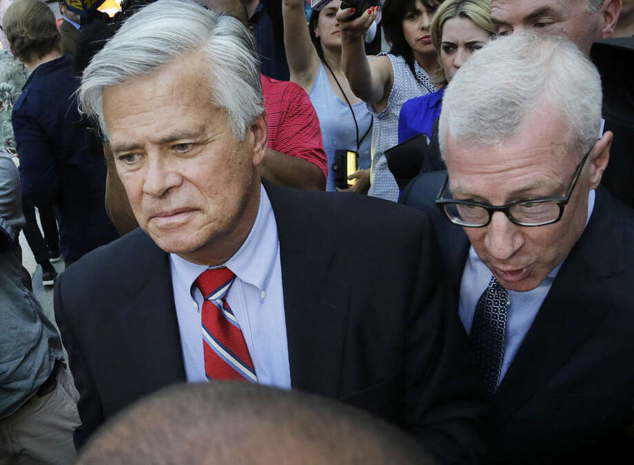New York Senate Majority Leader Dean Skelos, center, leaves federal court, Monday, May 4, 2015, in New York. Skelos and his son were arraigned on charges including extortion and soliciting bribes amid a federal investigation into the awarding of a $12 million contract to a company that hired his son. (AP Photo/Mark Lennihan)