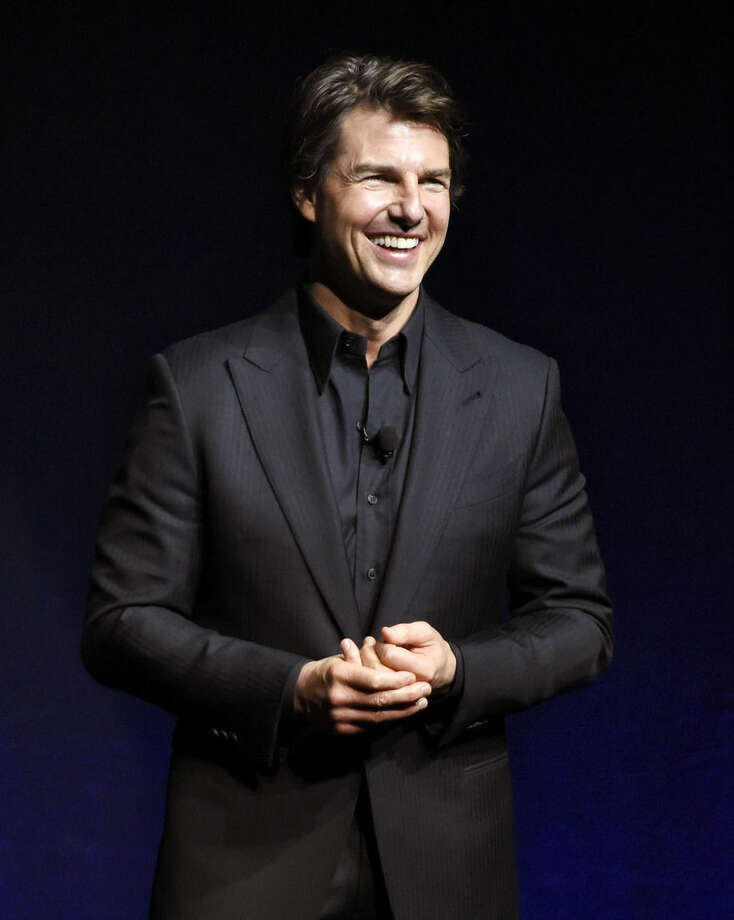 """FILE - In this April 21, 2015 file photo, Tom Cruise, star of the upcoming film """"Mission: Impossible - Rogue Nation,"""" makes an appearance at the Paramount Pictures presentation at CinemaCon 2015 in Las Vegas. Cruise was also featured in the Alex Gibney documentary, """"Going Clear: Scientology and the Prison of Belief."""" (Photo by Chris Pizzello/Invision/AP, File)"""