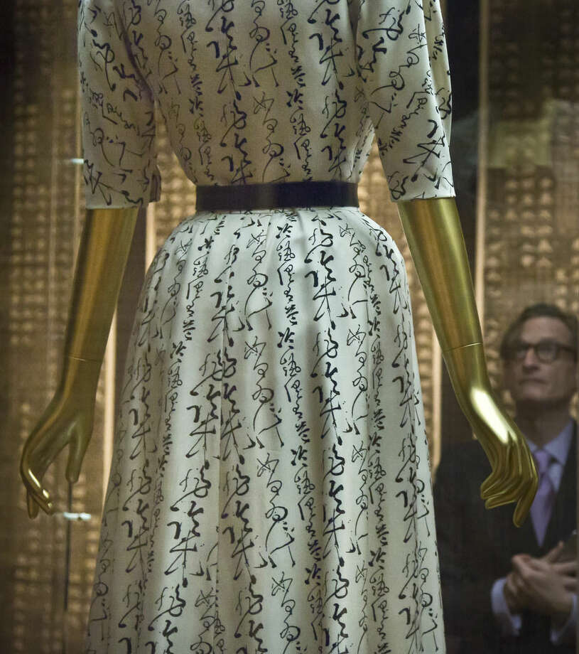 "A Chinese calligraphy printed dress from designer Gabrielle ""Coco"" Chanel, on display during the press preview for the Metropolitan Museum's Costume Institute exhibition ""China: Through the Looking Glass,"" Monday, May 4, 2015, in New York. (AP Photo/Bebeto Matthews)"