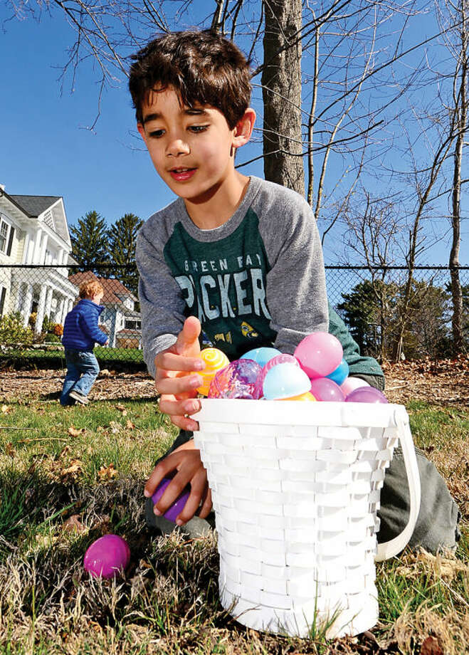 Hour photo / Erik Trautmann Max Makover searches for eggs at the Rowayton Civic Association annual Easter Egg Hunt at the Rowayton Community Center Saturday