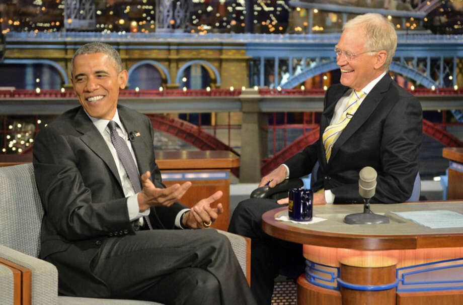 "In this image released by CBS, President Barack Obama, left, appears with host David Letterman during a taping of ""Late Show with David Letterman,"" on Monday, May 4, 2015, in New York. (John Filo/CBS via AP)"