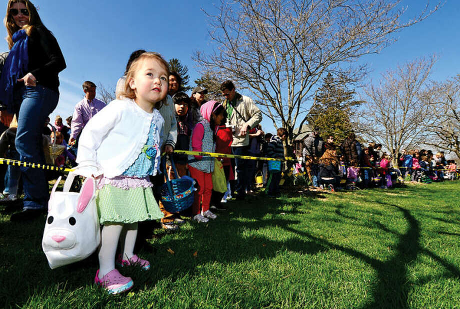 Hour photo / Erik Trautmann 2 year old Addison Pinzon gets ready to search for eggs at the Rowayton Civic Association annual Easter Egg Hunt at the Rowayton Community Center Saturday