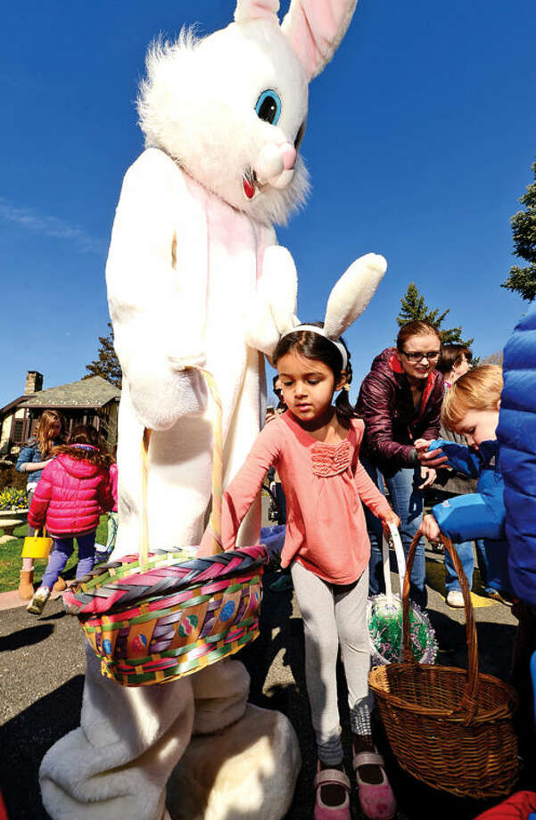 Hour photo / Erik Trautmann 5 year old MIchaela Moloney Seshan gets candy from the Easter Bunny at the Rowayton Civic Association annual Easter Egg Hunt at the Rowayton Community Center Saturday