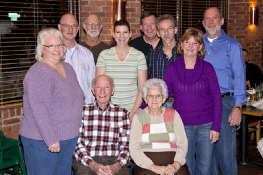 In this Dec. 29, 2012, photo provided by Dick Felumlee, Kenneth and Helen Felumlee, seated, of Nashport, Ohio., in central Ohio pose for a photo with their eight children. The Felumlees, who celebrated their 70th wedding anniversary in February, died 15 hours apart from each other last week. (AP Photo/Dick Felumlee)