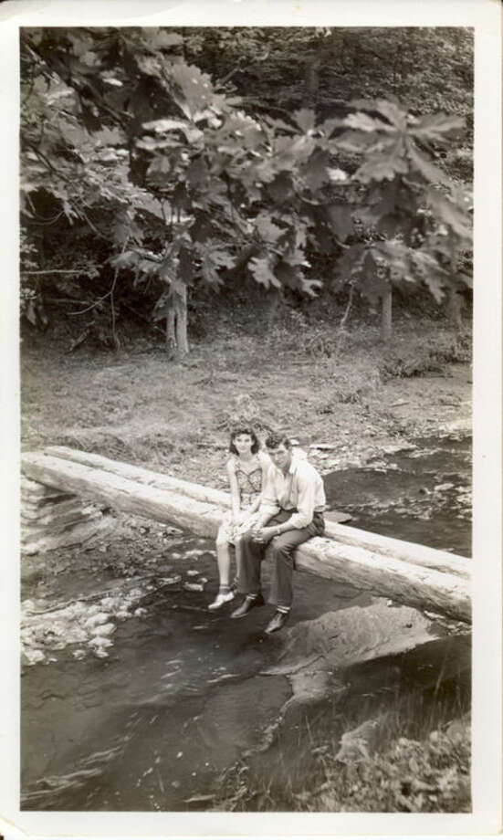 In this September 1940 photo provided by Dick Felumlee, Kenneth and Helen Felumlee of Nashport in central Ohio are shown sitting on a log north of Zanesville about four years before their marriage. The Felumlees, who celebrated their 70th wedding anniversary in February, died 15 hours apart from each other last week. (AP Photo/Felumlee family)