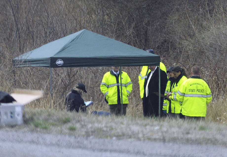 Massachusetts State Police stand along Interstate 190 where police said a child's body was found Friday, April 18, 2014, near Sterling, Mass. Worcester County District Attorney Joseph Early Jr., said the body has not been positively identified as Jeremiah Oliver, of Fitchburg, but that the height and weight of the body was consistent with Oliver's size. Jeremiah Oliver was last seen by relatives in September 2013 but wasn't reported missing until December. His mother Elsa Oliver and her boyfriend Alberto Sierra are both charged in the case. (AP Photo/Worcester Telegram & Gazette, Tom Rettig)