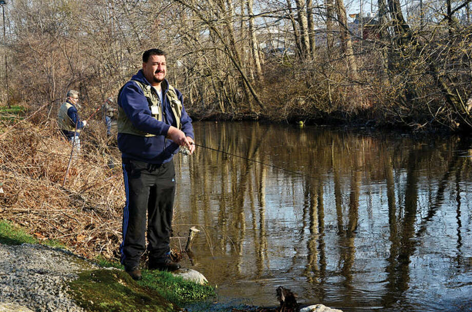 Hour photo / Erik Trautmann Ken Sherwood fishes along the Norwalk River in Wilton on the opening day of trout season Saturday.