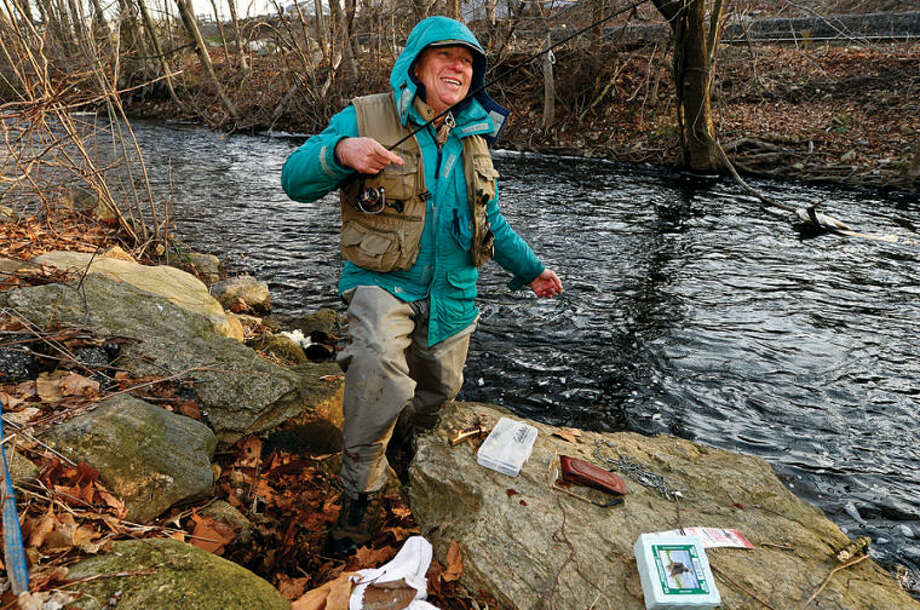 Hour photo / Erik Trautmann Bill Geils fishes along the Norwalk River in Wilton on the opening day of trout season Saturday.