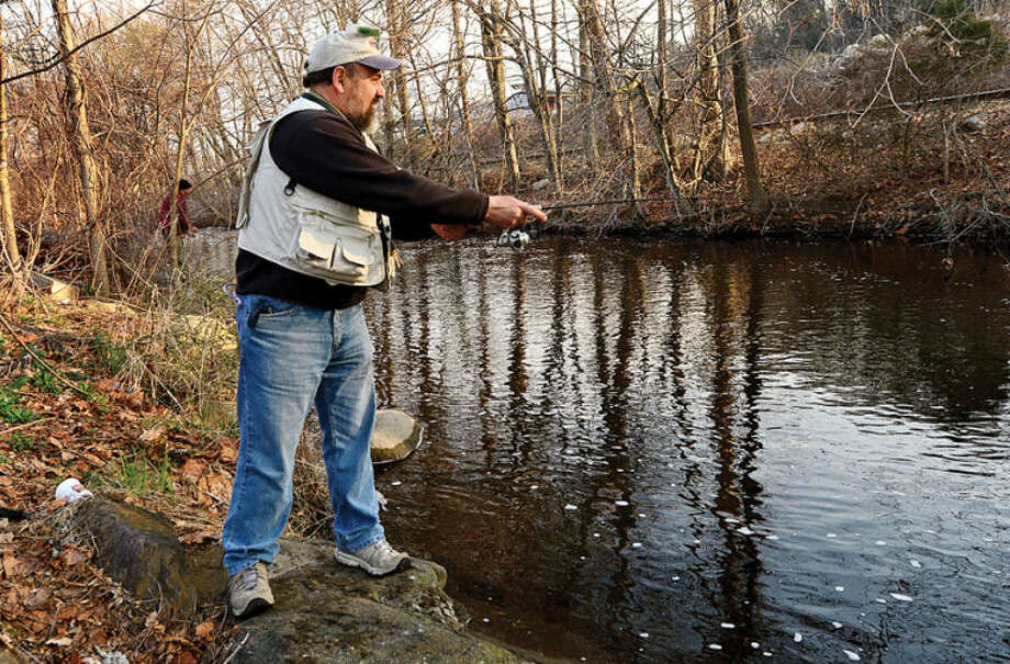 Hour photo / Erik Trautmann Al Goncalves fishes along the Norwalk River in Wilton on the opening day of trout season Saturday.