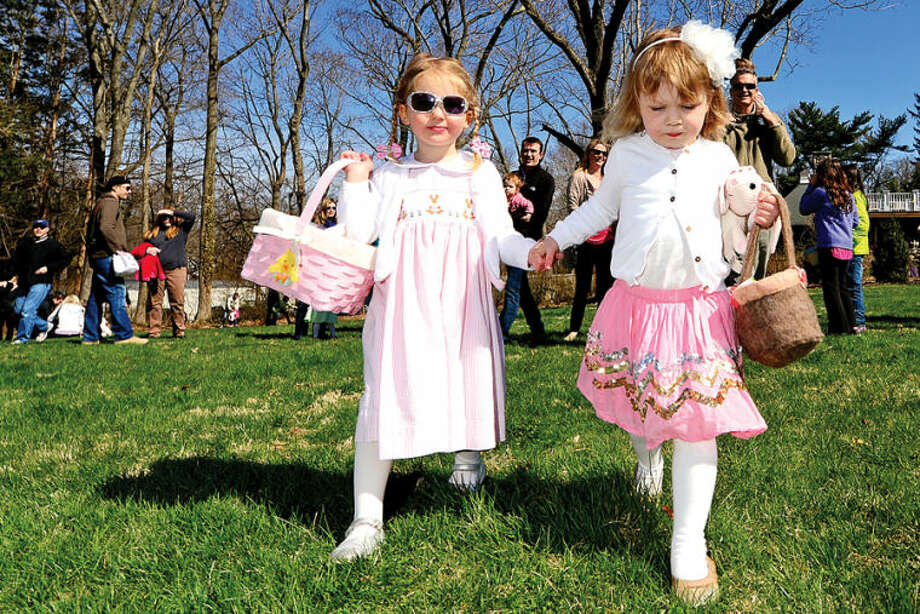 Hour photo / Erik Trautmann Best Friends Daisy Winn and Ruby Stowe, both 3, search for eggs at the Rowayton Civic Association annual Easter Egg Hunt at the Rowayton Community Center Saturday.