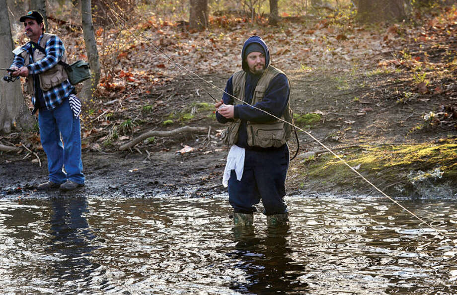 Hour photo / Erik Trautmann Mike Rossi fishes along the Norwalk River in Wilton on the opening day of trout season Saturday.
