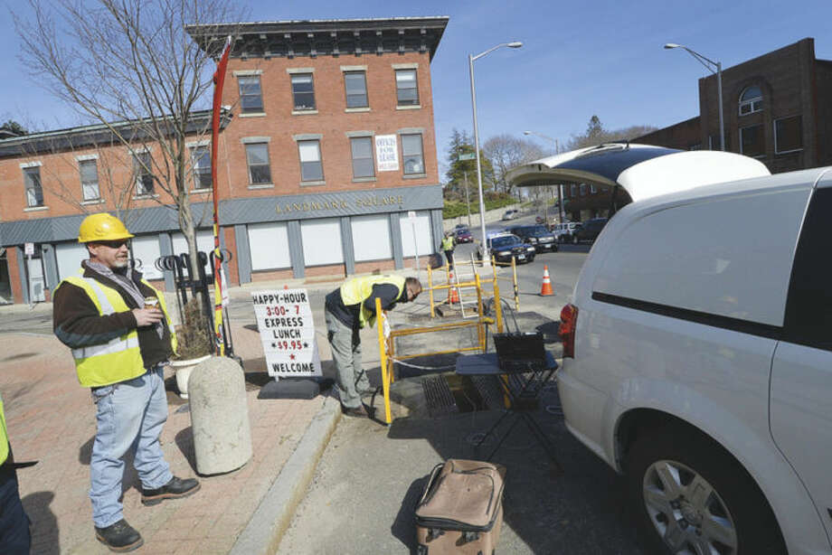 Hour Photo/Alex von Kleydorff Crews from CL&P work at the corner of Knight and Wall street in Norwalk Thursday