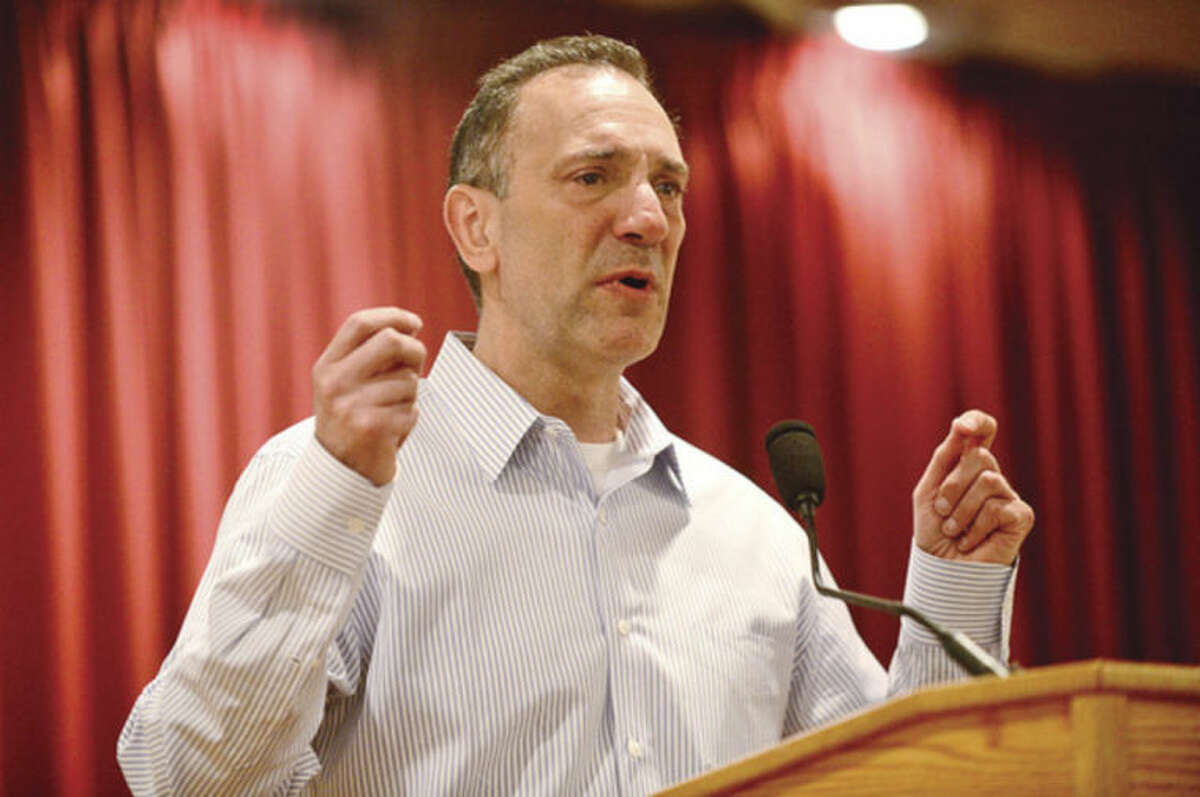 Hour photo / Erik Trautmann Keynote speaker, Gary Mendell, Founder and CEO of Shatterproof, shares his experience of losing his son, Brian, to addiction during the Pivot Ministries Prayer Breakfast Friday morning at Continental Manor.
