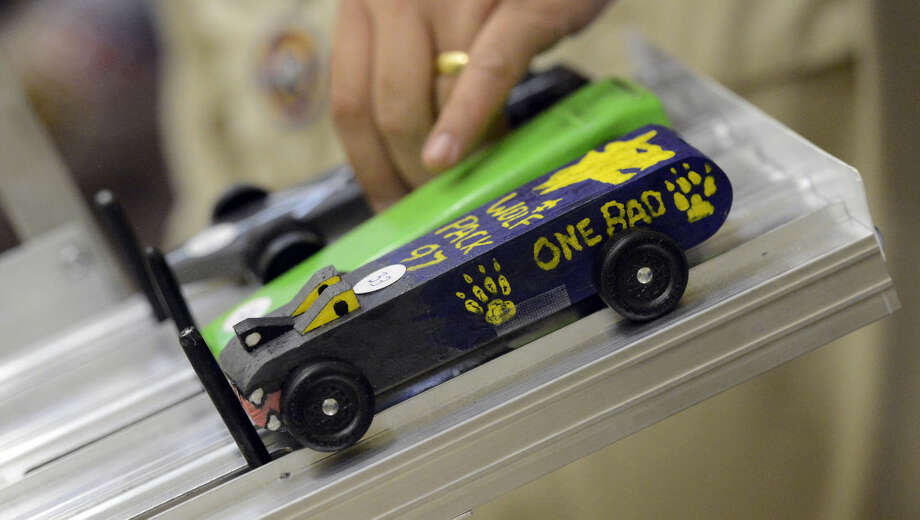 Pine racers are set for a start during the Powahay District's Pinewood Derby Championship in New Canaan on April 30, 2016.