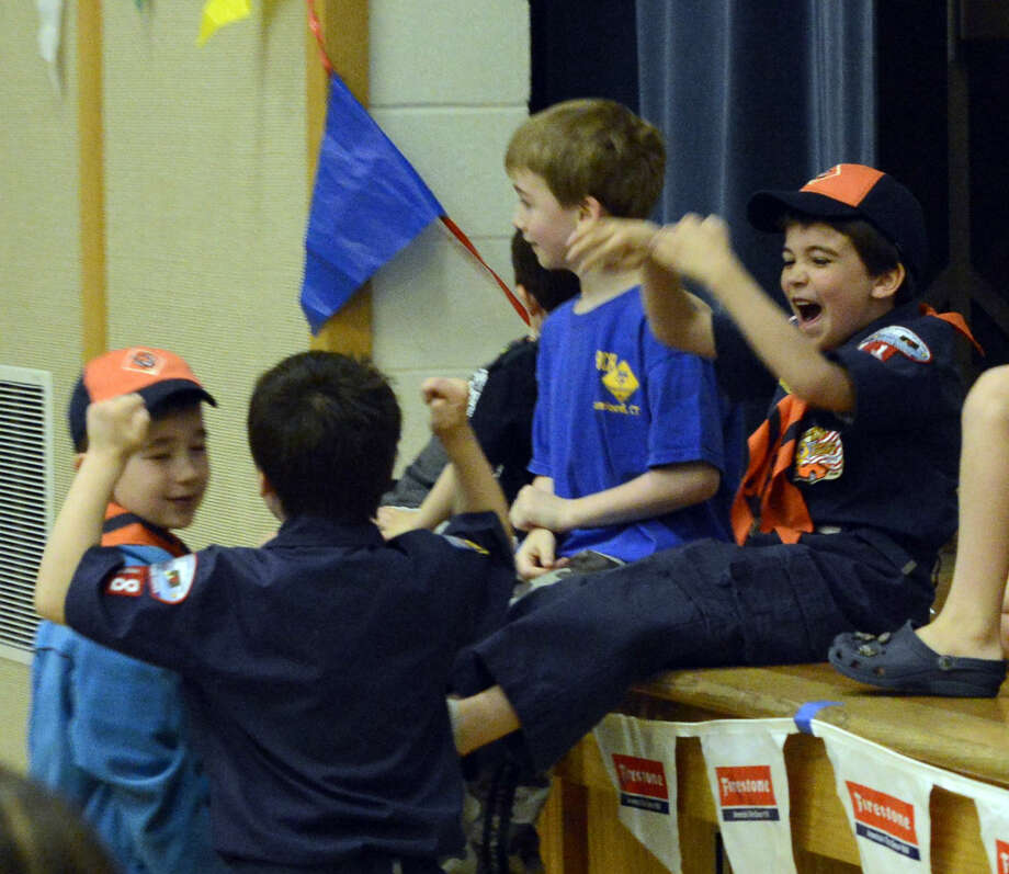 Lucas Morgan, of Stamford Pack 11, at right, reacts to his first place finish in the prelims for the Tiger Scouts division during the Powahay District's Pinewood Derby Championship in New Canaan on April 30, 2016.