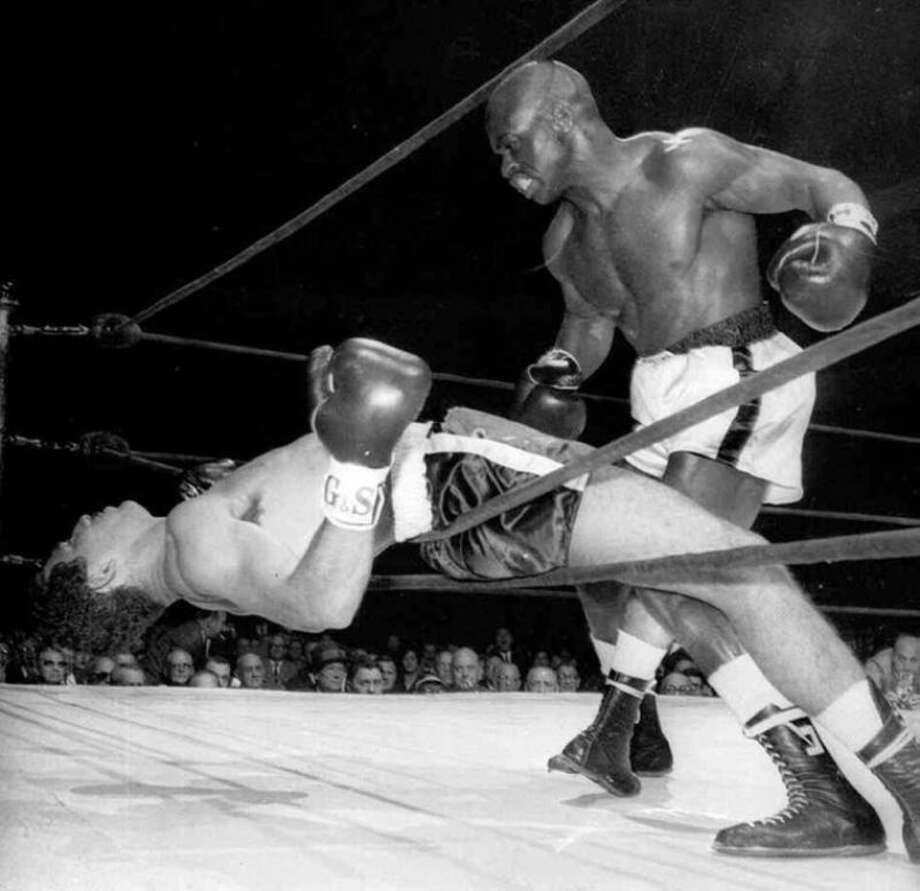 "Rubin ""Hurricane"" Carter of Paterson, N.J., watches Florentino Fernandez of Cuba fall."