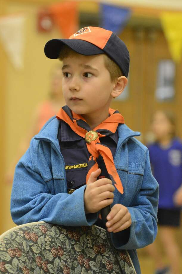Kyler Warner of Stamford Pack 48 starts the next race during the Powahay District's Pinewood Derby Championship in New Canaan on April 30, 2016.