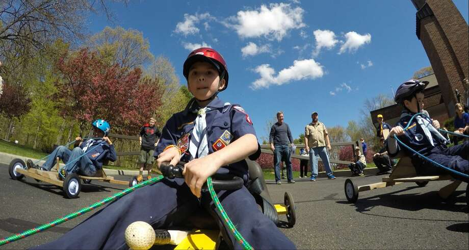 A.J. Pellicci, 8, of Stamford Pack 48, participates in a kart race during the Powahay District's Pinewood Derby Championship in New Canaan on April 30, 2016.