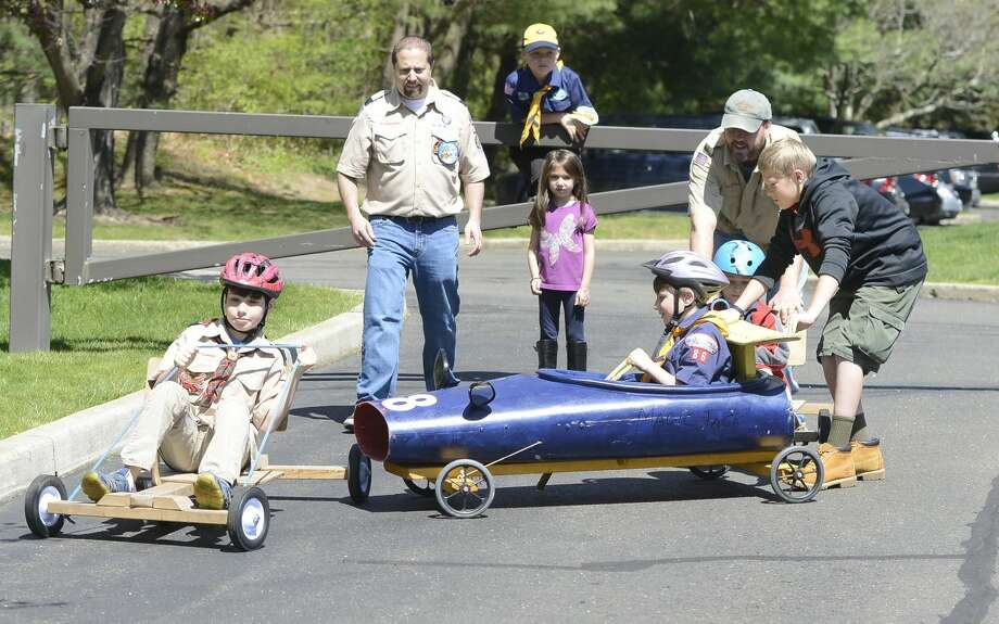 Scouts participate in kart racing during the Powahay District's Pinewood Derby Championship in New Canaan on April 30, 2016.