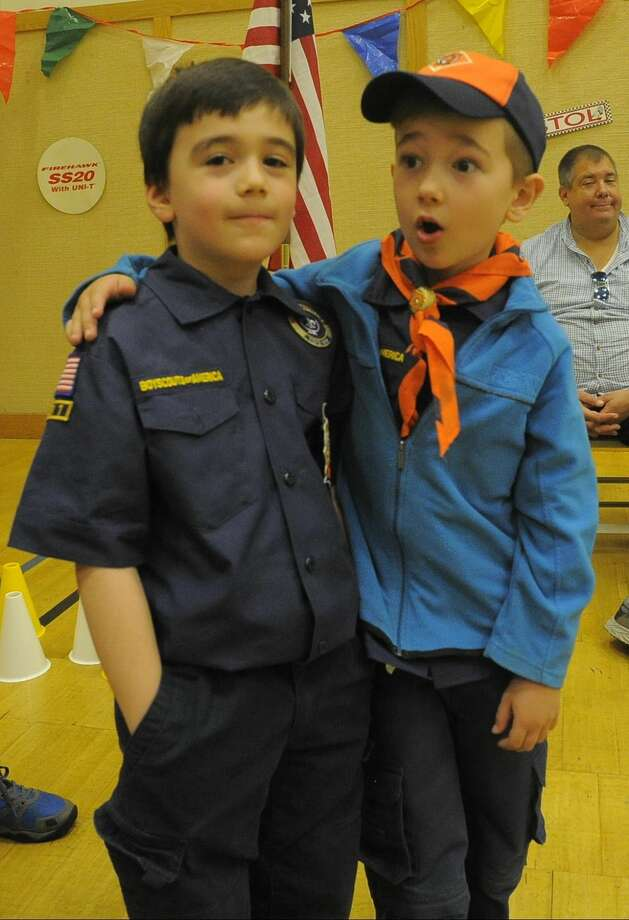 Sam wolff and Kyler Warner of Stamford Pack 11 and 48 react as Warner name is announced as one of the top six competitors in the Cub Scout Wolf division during the Powahay District's Pinewood Derby Championship in New Canaan on April 30, 2016.