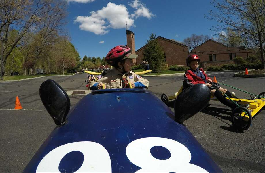 Brett Newman, 9, of Stamford Pack 48, participates in a kart race during the Powahay District's Pinewood Derby Championship in New Canaan on April 30, 2016.