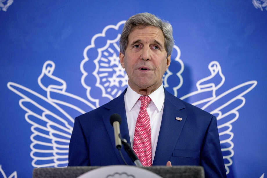Secretary of State John Kerry gives a statement after meeting with President Hassan Sheikh Mohammed and Prime Minister Omar Abdirashid Ali Sharmarke at the airport in Mogadishu, Somalia, Tuesday, May 5, 2015, in a show of solidarity with the Somalian government trying to defeat al-Qaida-allied militants and end decades of war in the African country. Kerry is the first secretary of state to visit Somalia. (AP Photo/Andrew Harnik, Pool)