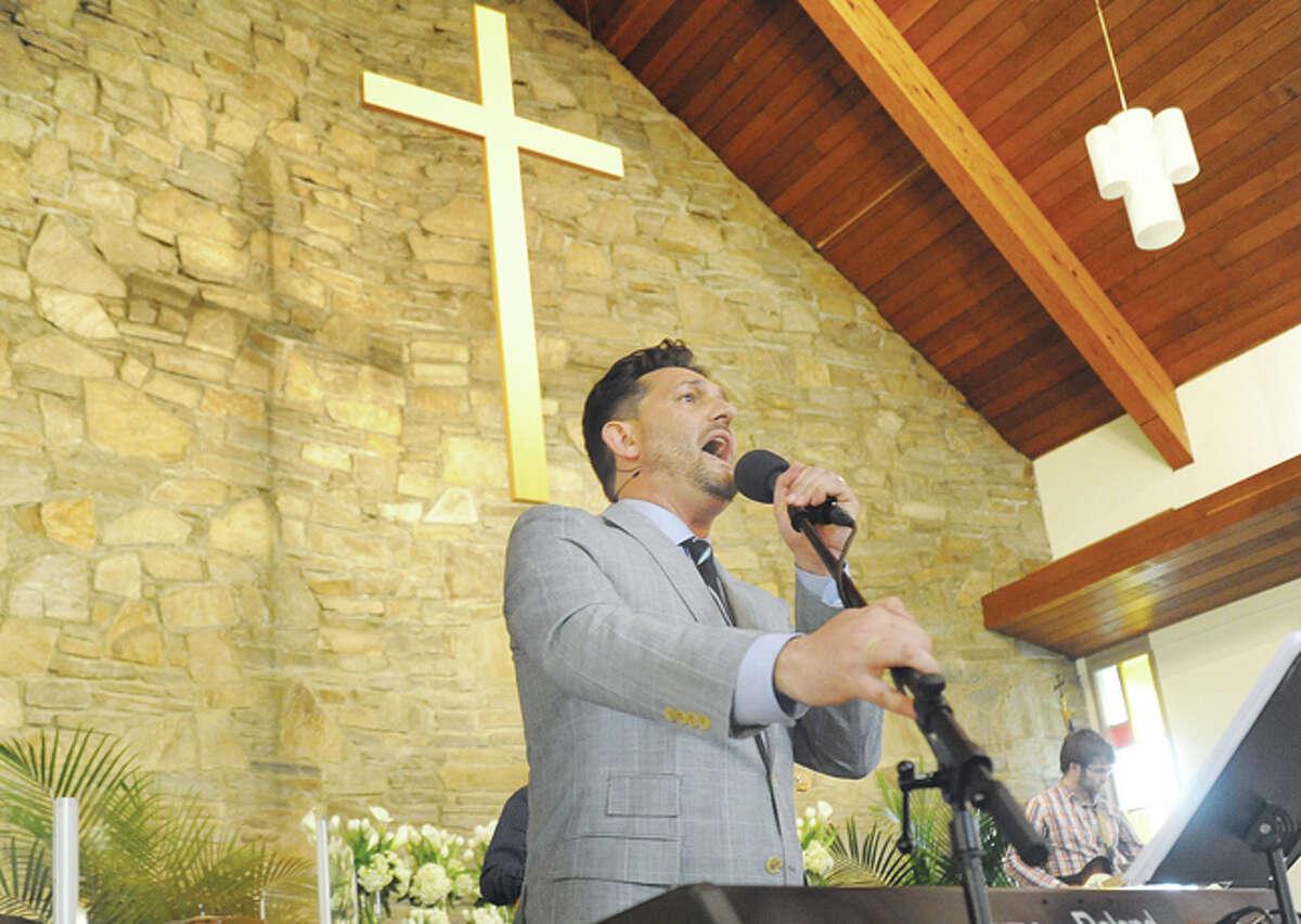 Pastor Kevin Mullis performs songs of praise at the Church of the Good Shepherd Easter Sunday celebration in Norwalk. Hour photo/Matthew Vinci