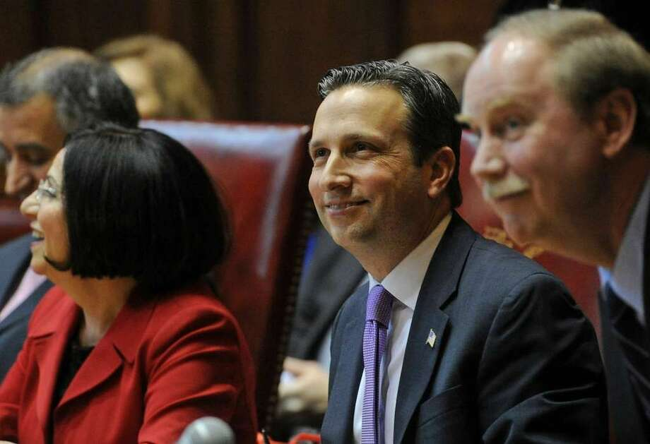 Sen. Toni Boucher, R-Wilton, left and Sen. Michael McLachlan, R-Danbury, right, were critical of a surprise attempt by Democrats to raise the minimum wage to $12 an hour by January, 2020. After a nearly five-hour debate, Sen. Majority Leader Bob Duff, D-Norwalk, center, withdrew the bill from consideration late Thursday night. (Photo: Brian Pounds)