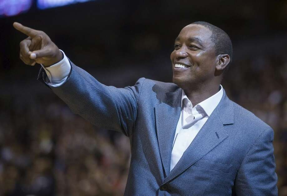 FILE - In this Oct. 5, 2014, file photo, Isiah Thomas acknowledges applause from the crowd during a pre-season NBA basketball game between the Toronto Raptors and Sacramento Kings in Vancouver, British Columbia. Madison Square Garden chairman James Dolan has rehired Isiah Thomas _ this time to run the WNBA's New York Liberty. The Liberty said Tuesday, May 5, 2015, that Thomas will serve as team president with responsibility for basketball and business operations. He has also taken an ownership interest in the team.(AP Photo/The Canadian Press, Darryl Dyck)
