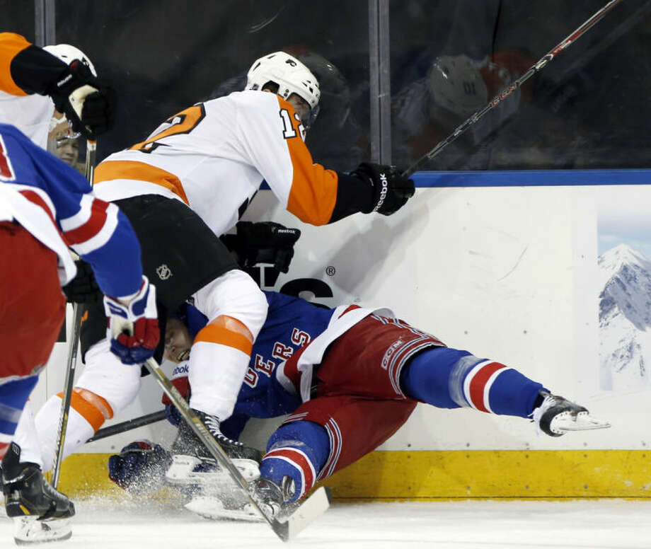 Philadelphia Flyers left wing Michael Raffl (12) sends New York Rangers defenseman Anton Stralman (6) of Sweden to the ice in the first period of Game 2 of the first round of the Stanley Cup hockey playoffs at Madison Square Garden in New York , Sunday, April 20, 2014. (AP Photo/Kathy Willens)