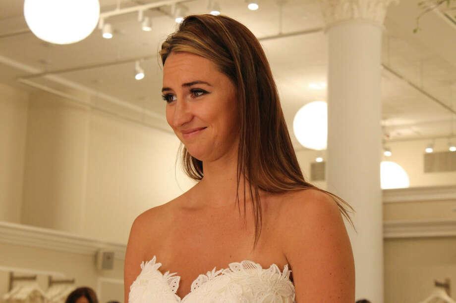 Alyssa Brezovsky trying on the fourth wedding dress.