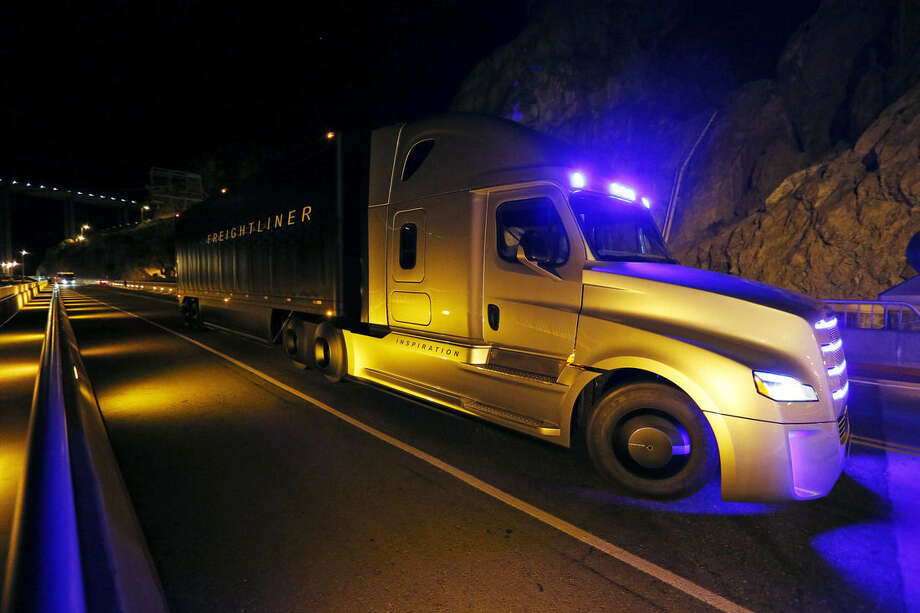 Freightliner unveils its Inspiration self-driving truck during an event at the Hoover Dam Tuesday, May 5, 2015, near Boulder City, Nev. (AP Photo/John Locher)
