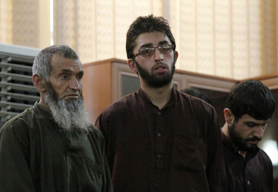 Defendants attend a hearing in the case of a 27-year-old Afghan woman named Farkhunda who was beaten to death in a frenzied attack sparked by a bogus accusation that she had burned a copy of the Quran, at the Primary Court in Kabul, Afghanistan, Wednesday, May 6, 2015. The Afghan court on Wednesday convicted and sentenced four men to death for their role in the brutal mob killing in Kabul in March — a slaying that shocked the nation and spurred calls for authorities to ensure women's rights to equality and protection from violence. (AP Photo/Allauddin Khan)