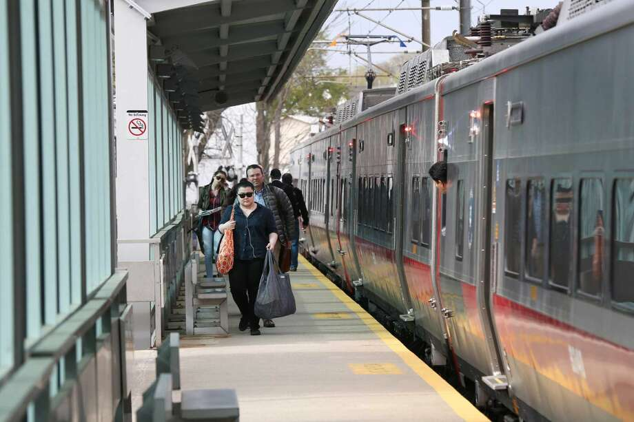 Commuters get off the Metro North train at the Springdale train station on Thursday, April 28, 2016. The city of Stamford may increase the daily parking fees at commuter lots in Glenbrook and Springdale from $3 to $5.