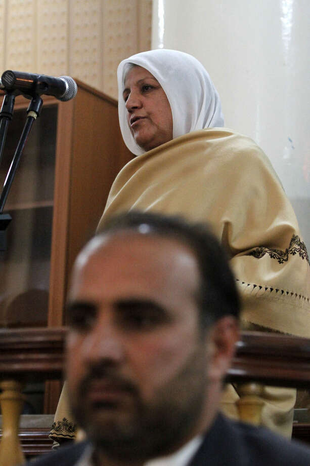 Bibi Hajira, the mother of a 27-year-old Afghan woman named Farkhunda, who was beaten to death in a frenzied attack sparked by a bogus accusation that she had burned a copy of the Quran, speaks at a hearing at the Primary Court in Kabul, Afghanistan, Wednesday, May 6, 2015. The Afghan court on Wednesday convicted and sentenced four men to death for their role in the brutal mob killing in Kabul in March — a slaying that shocked the nation and spurred calls for authorities to ensure women's rights to equality and protection from violence. (AP Photo/Allauddin Khan)