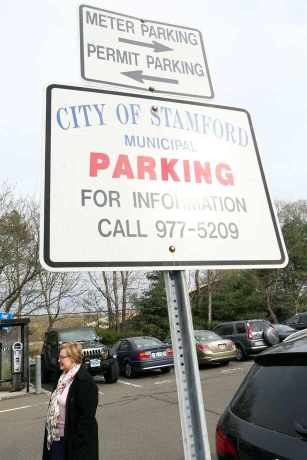 Parking sign in the Springdale train station parking lot.