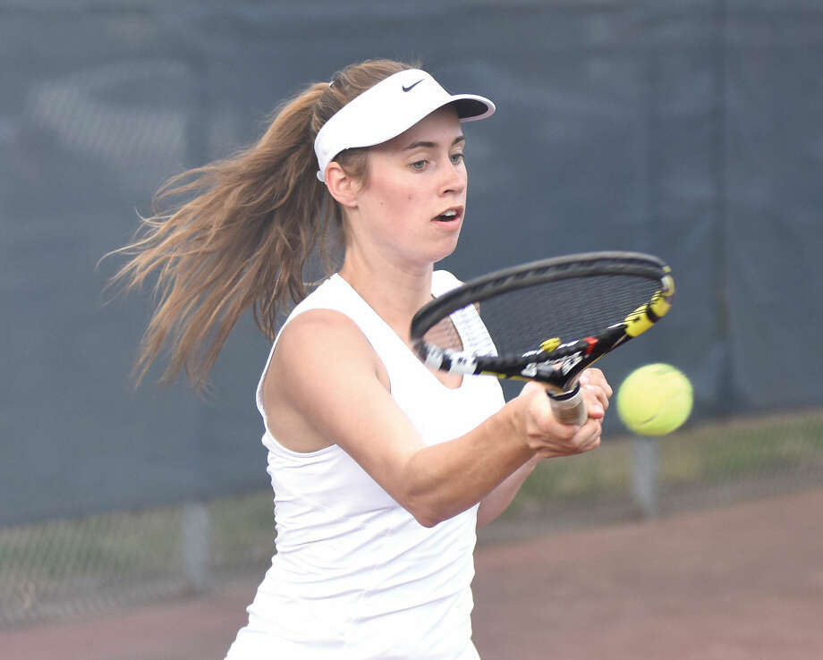 Wilton's Maddi Stow puts some spin on her return during her No. 1 singles victory against New Canaan on Tuesday. TheWarriors beat the Rams 5-2. (Hour photo/John Nash)