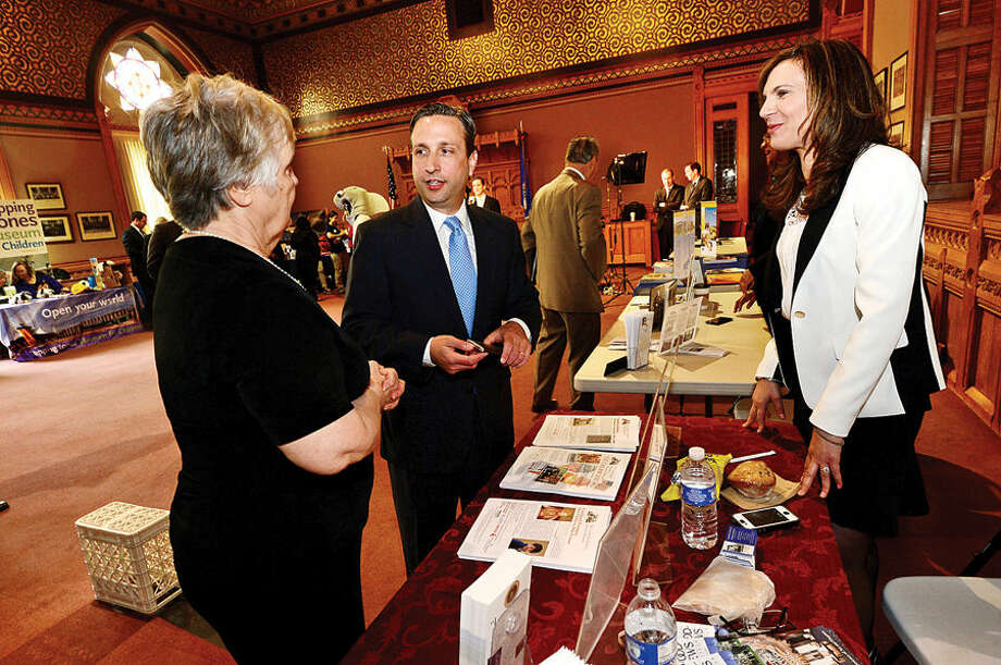 Hour photo / Erik Trautmann State Senator and Majority leader Bob Duff (D-25) chats with Patsy Brescia and Susan Gilgore of the Lockwood Mathews Mansion Museum as Duff hosts the first-ever Norwalk Day at the Capitol Wednesday where city officials and numerous Norwalk businesses and organizations showcased Norwalk.