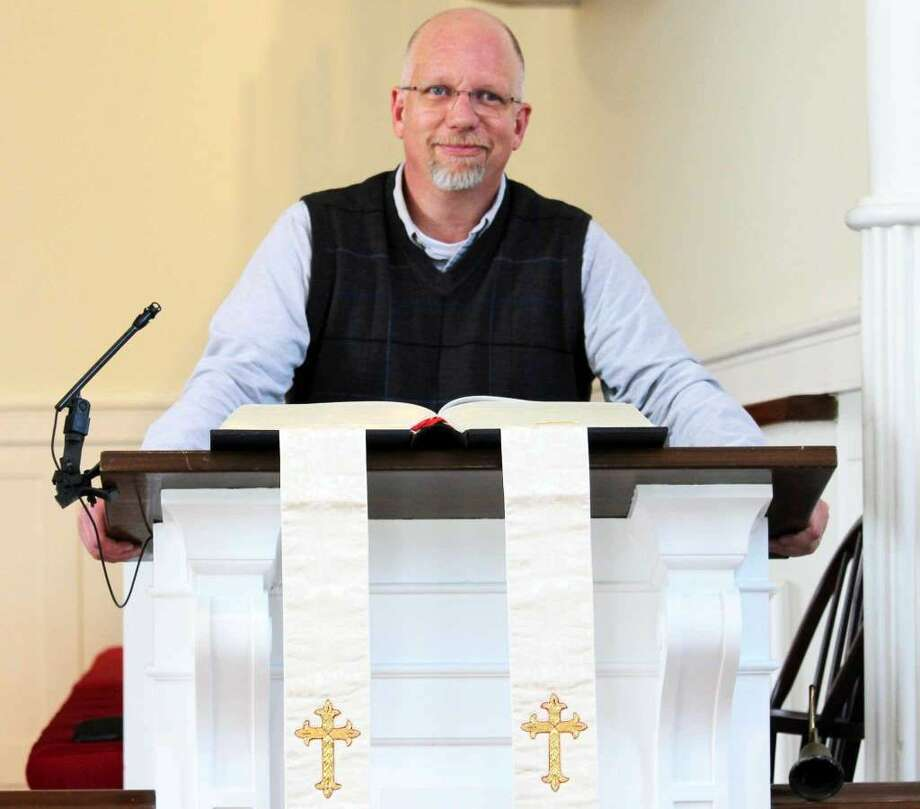 """The Rev. Dave Stambaugh at the pulpit of the Congregational Church of Green's Farms. Stambaugh portrayed one of the players on the Little League team in the 1976 movie, """"The Bad News Bears."""" (Photo:Chris Marquette)"""