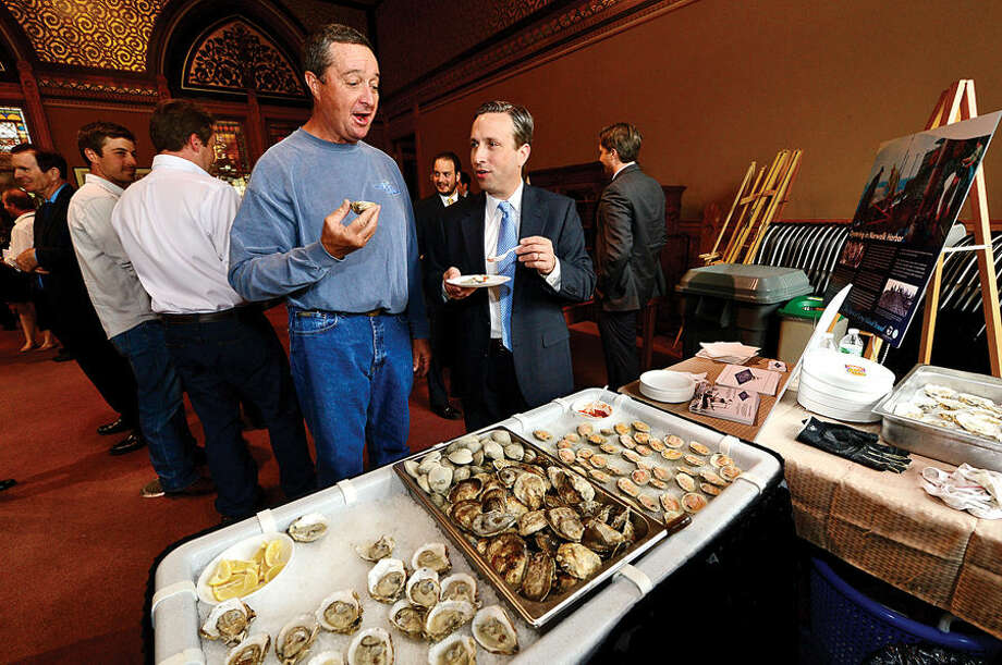 Hour photo / Erik Trautmann Shellfisherman Norm Bloom joins State Senator and Majority leader Bob Duff (D-25) as he hosts the first-ever Norwalk Day at the Capitol Wednesday where city officials and numerous Norwalk businesses and organizations showcased Norwalk.