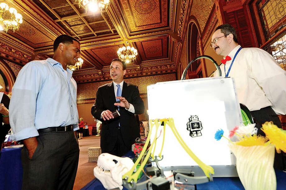 Hour photo / Erik Trautmann State Senator and Majority leader Bob Duff (D-25) chats with Vladimir mariano of the Maker's Guild and Luis Ayala of the Norwalk Public Library as Duff hosts the first-ever Norwalk Day at the Capitol Wednesday where city officials and numerous Norwalk businesses and organizations showcased Norwalk.