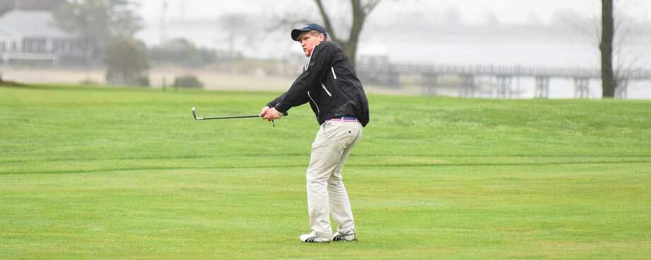 Colby Scovel hits a shot from the fairway of the first hole.
