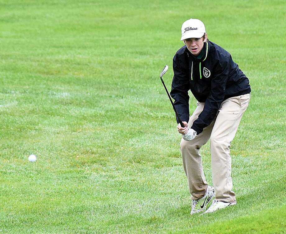 Ryan Byrne of Norwalk chips on to the sixth green.
