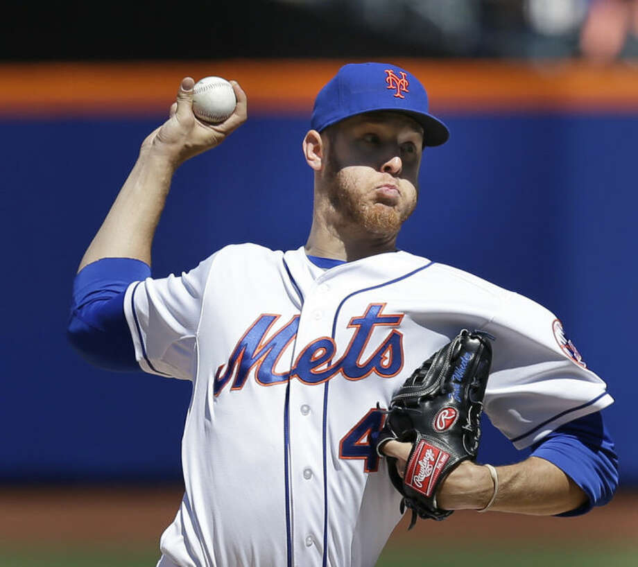 New York Mets starting pitcher Zack Wheeler throws during the fourth inning of a baseball game against the Atlanta Braves, Sunday, April 20, 2014 in New York. (AP Photo/Seth Wenig)