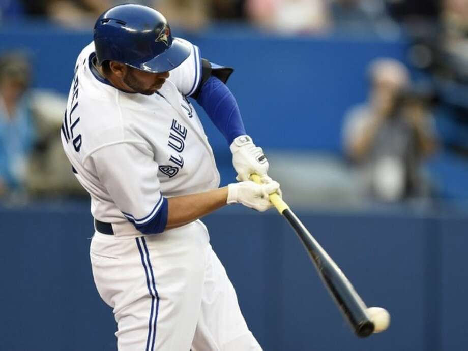 Toronto Blue Jays' Ezequiel Carrera hits a two run single during second inning American League baseball action against the New York Yankees in Toronto, Tuesday, May 5, 2015. Blue Jays' Kevin Pillar and Chris Colabello scored on the play. (Frank Gunn/The Canadian Press via AP) MANDATORY CREDIT
