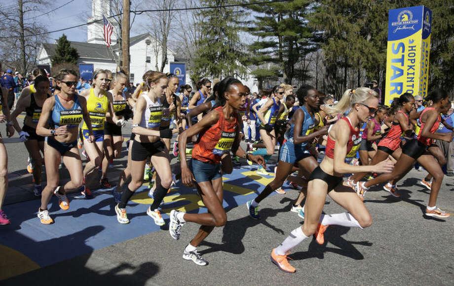 Elite women runners leave the start line of the 118th Boston Marathon Monday, April 21, 2014 in Hopkinton, Mass. (AP Photo/Stephan Savoia)