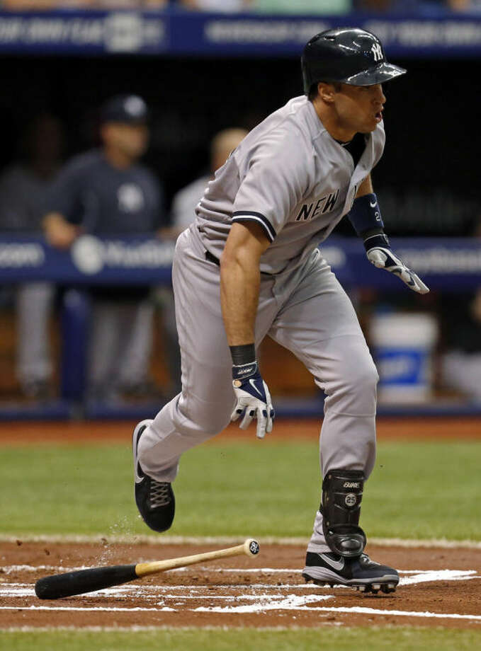 New York Yankees' Mark Teixeira singles during the second inning of a baseball game against the Tampa Bay Rays, Sunday, April 20, 2014, in St. Petersburg, Fla. (AP Photo/Mike Carlson)