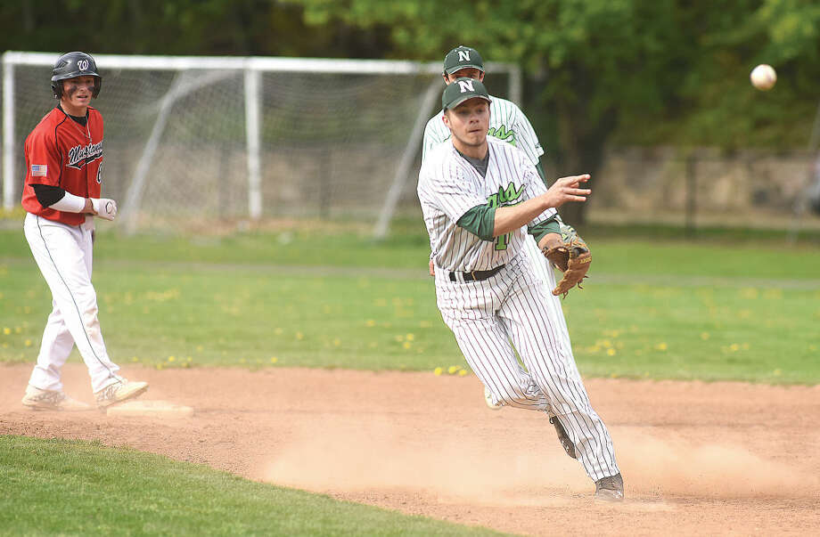 Hour photo/John Nash - Norwalk second baseman Dave Balunek fires to first base to complete a double play after tagging out Fairfield Warde's Dakota DeJordy in the first inning of Wednesday's FCIAC baseball game in Norwalk.