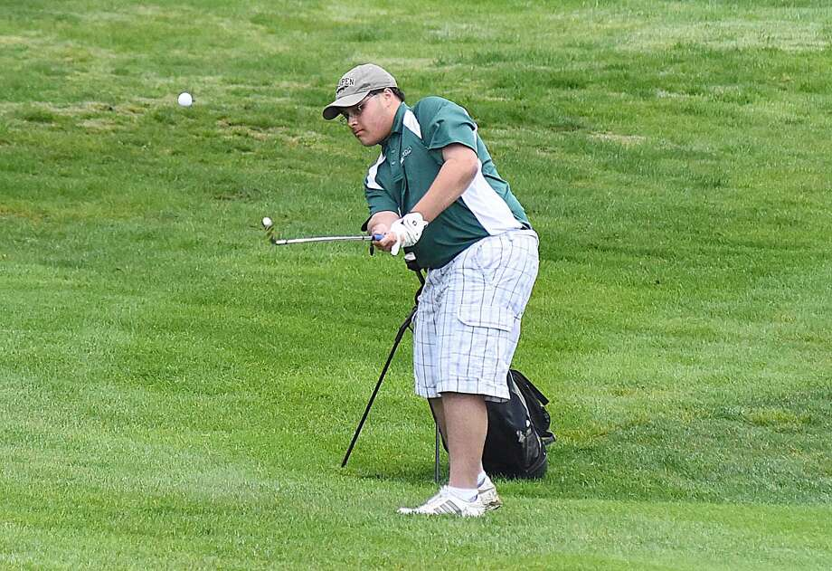 Norwalk's Anthony Africano chips onto the green.