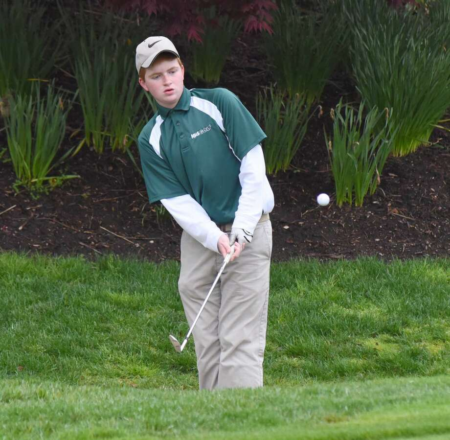 Norwalk's Barry Belardinelli chips from the back rough off the sixth green during Tuesday's city matchup against Brien McMahon at the Shorehaven Golf Club in East Norwalk. Norwalk won its second straight Courville Cup Trophy with a 213-235 win.